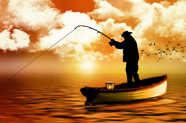 rybář na člunu